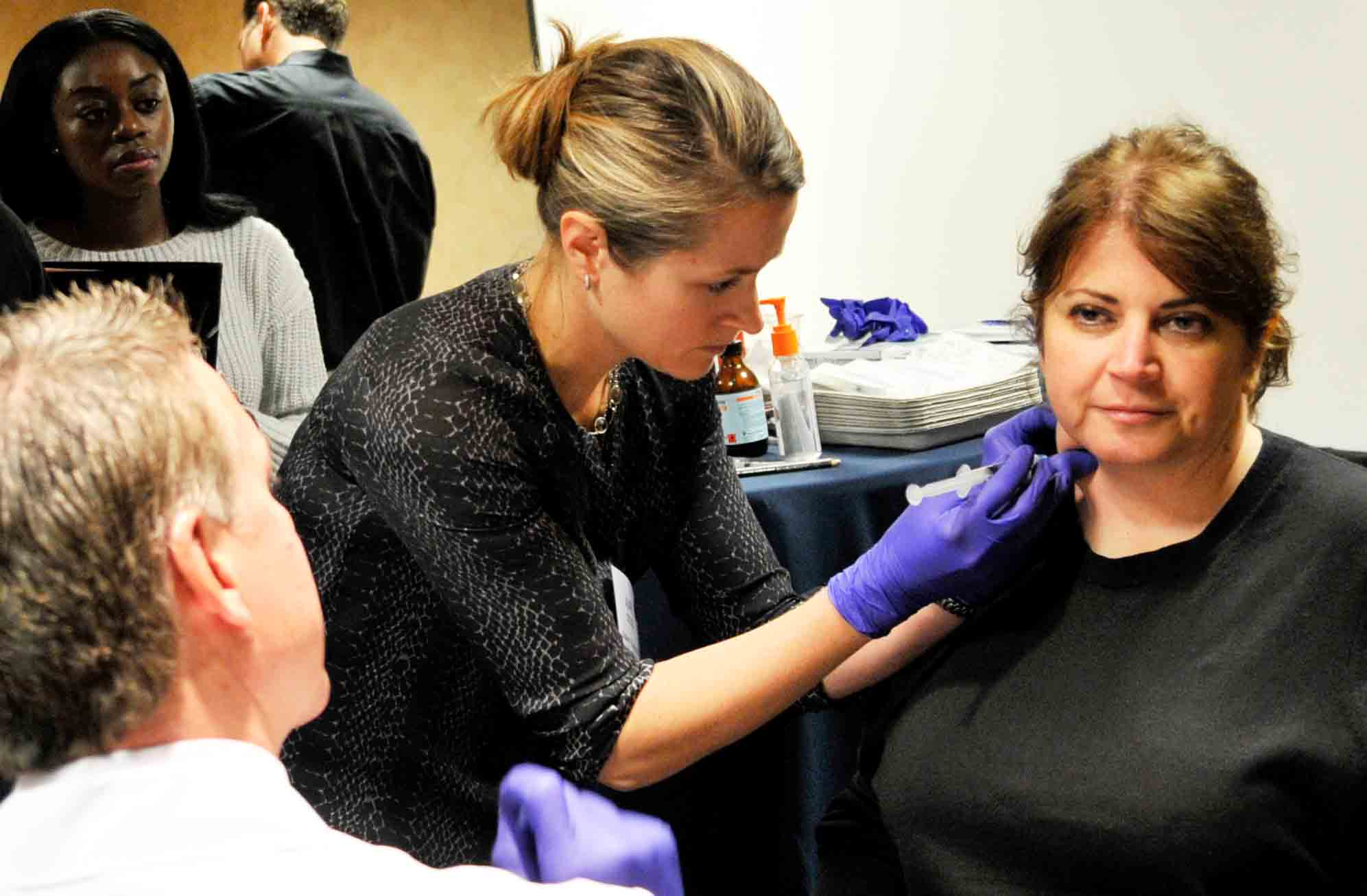 Dr. Caughey places the Botox injection in the masseter muscle.